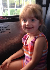My first bus ride. We're going to the moon bounce place.